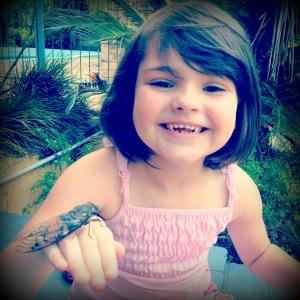 Charlie holding a cicada.